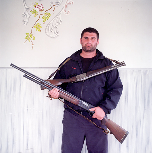 Ruslan lives in the village of Ashe located in an area where a few thousand Circassians live in compact communities. He poses for picture with hunting guns. Local Circassians remain very attached to their land and faithful to their ancestors' pastimes eagerly talking of their hunting feats and 19th century battles. Circassian tribes living along the Black sea shore waged the fiercest resistance to the Russian army during the century-long Russian-Caucasian war. ASHE/SOCHI, RUSSIA, MAY 2009.