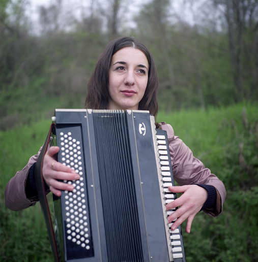 Svetlana, member of a Circassian folk troupe, with an accordion. ASHE/SOCHI, RUSSIA, MAY 2009
