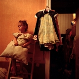 RUSSIA / St.Petersburg / July 2007 / Nastya, 4, waits while her mother makes her bed. Nastya lives with her parents and a sister in a 20-square-meter room. This one-family-one-room situation is very common in St.Petersburg.