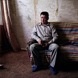 RUSSIA / St.Petersburg / July 2007 / Misha, a migrant worker from Kyrgyzstan, has been living in this communal room for the last 20 years. Relatively cheap rent in communal housing allows him to support his family in his home country.  