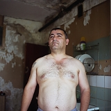 RUSSIA / St.Petersburg / July 2007 / A migrant worker from Azerbaijan who refused to give his name poses for picture in a dilapidated communal kitchen.   