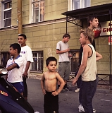 RUSSIA / St.Petersburg / July 2007 / Youths hang out in the street in an area where most housing is communal.  