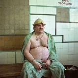 RUSSIA / St.Petersburg / August 2007 / A man relaxing after having a bath in a public bath. In many communal appartments, there is still no hot water so people have to go to public baths to wash. 