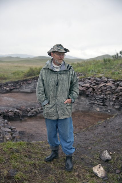 Konstantin V. Chugunov, an archaeologist with the State Hermitage Museum in St. Petersburg, posing for picture in front of a burial mound being excavated by an expedition he leads in the so-called Valley of Kings in northern Tuva. Mr Chugunov has dedicated almost his entire career to exploring the ancient monuments of Tuva. In 2003, he and Hermann Parzinger of the German Archaeological Institute in Berlin have discovered here a rich burial of a noble Scythian, his wife and guards with thousands of golden and other paraphernalia. The largest part of the discovery is displayed at the National Museum of Tuva in Kyzyl, a smaller part - at The Hermitage Museum in St. Petersburg.